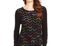 Woven multicolored zigzag stripes of yarn add a