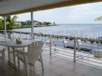 Big home with a boat dock,pool,patio area to BBQ and a