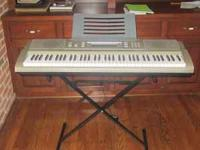 Casio WK200 76 key personal keyboard with stand,