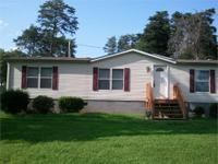 Big Doublewide home set on 4.5 acres. Excellent country
