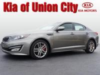 It's hard to resist this dk. gray 2013 Kia Optima SX!
