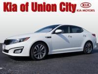 Say hello to your new vehicle, this white 2014 Kia