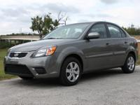 2011 Kia Rio in Titanium on Gray cloth interior. Only