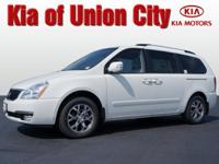 Set your sights on this white 2014 Kia Sedona LX. It