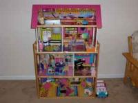 This doll house is in great shape. Predominately pink