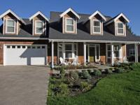 Relax in this brand new Cape Cod style home. Tastefully