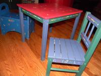This farmhouse table is colorfully painted with primary