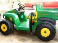 "Kid's ""John Deere Gator"" tractor. Has a batter, but"