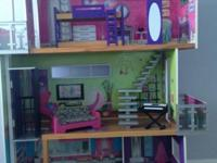 This KidKraft Designer Dollhouse has a hip, modern look