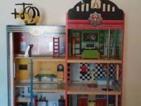 I have a KidKraft Firehouse Wooden Play Set for sale.