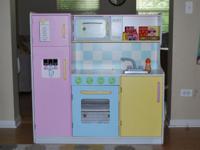 - KidKraft wood kitchen, pastel: $80 (at Lowes.com