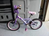 Bratz 16 inch purple bike with bag on front and new