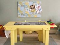 Solid wood activity table with craft paper roll at one