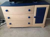 Kids captain bed with headboard and matching dresser.