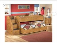 Selling kids bunk bed just like this. It comes with two