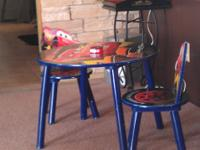 For sale is a Cars table and chairs for a kids room.