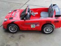 A kids red corvette battery operated in good condition.