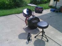 Black toy drumset, only missing drumsticks Please call