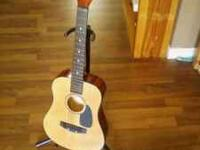 This is a CHILDRENS First Act Sedona Acoustic Guitar.