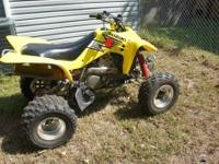 Like new Suzuki 80 4-wheeler. Yellow in color. Plastic