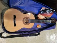 Kids Hohner guitar. Great condition. Comes with