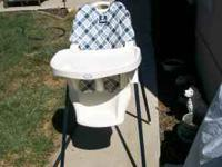 This is a Blue checkered Highchair. This chair is in