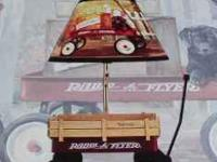 Here we have a new in the box Radio Flyer Lamp. This