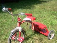 A nice radio flyer tricycle with bell ringer and