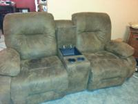 Suede chocolate brown kids recliner. Has a built in cup
