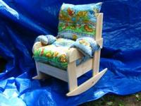 This rocker is made from pine and has a clear finish.