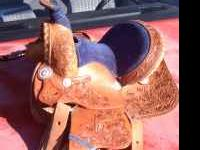 Almost new 12 inch child's roping/ barrel saddle has
