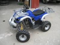selling a small 4 wheeler looks to be about a 100cc 4
