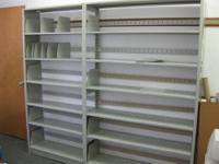 KIDS STAND WITH 3 SHELVES IN GOOD CONDITION $25.00 SEE