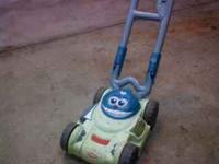 Kids tow lawn mower. Makes noise when pushed. My son