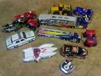 Lot of trucks, some have remotes, trailers, all in