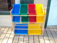 Colorful kids toy storage bins. Well used. One bin is
