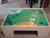 I am selling a kids train table with four storage bins.