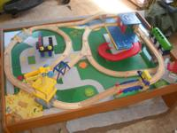 Table comes with extra buildings, and tracks. Has a ton