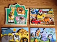4 wooden puzzles.  Two Melissa & Doug, one Disney
