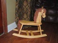 I HAVE A SOLID WOODEN ROCKING HORSE THAT IS IN