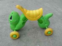 It's a worm that kids can ride on. It flexes in the