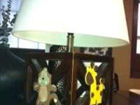 This Lamp has a Zebra, Giraffe and a Monkey on it. call