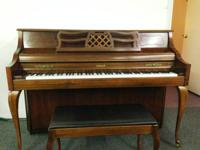 This Kimball Console Piano was built in 1991. The piano