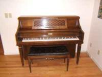 Beautiful Kimball console piano stained in a dark