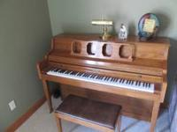 Kimball upright oak piano with bench. great shape call