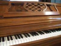 This is a beautiful Kimball console piano, manufactured
