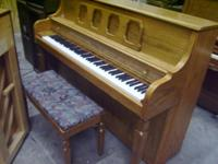 Kimball Piano, Red Mahoganey. With Bench. The piano was