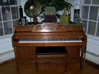 Used piano with padded storage bench, asking $500.00