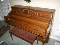 Very nice pecan finish piano in excellent condition.