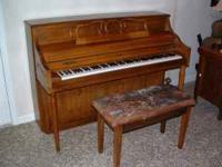 Kimball upright piano with bench. In good condition.